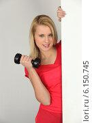 Купить «Young woman with a dumbbell», фото № 6150745, снято 9 марта 2010 г. (c) Phovoir Images / Фотобанк Лори