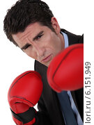 Купить «Businessman wearing boxing gloves», фото № 6151949, снято 8 апреля 2011 г. (c) Phovoir Images / Фотобанк Лори