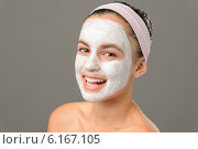 Купить «Smiling teenage girl face mask bare shoulders», фото № 6167105, снято 1 июля 2014 г. (c) CandyBox Images / Фотобанк Лори