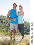 Купить «Fit couple standing at summit smiling at camera», фото № 6168405, снято 6 февраля 2014 г. (c) Wavebreak Media / Фотобанк Лори