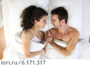 Купить «Couple lying in bed», фото № 6171317, снято 2 марта 2010 г. (c) Phovoir Images / Фотобанк Лори