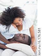 Купить «Attractive couple cuddling on the couch», фото № 6176581, снято 30 апреля 2014 г. (c) Wavebreak Media / Фотобанк Лори