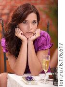 Купить «Upset woman sat alone at the restaurant», фото № 6176617, снято 6 сентября 2010 г. (c) Phovoir Images / Фотобанк Лори