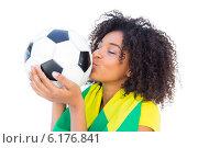 Купить «Pretty football fan with brazilian flag kissing ball», фото № 6176841, снято 30 апреля 2014 г. (c) Wavebreak Media / Фотобанк Лори