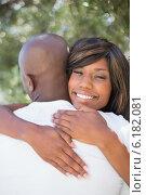 Купить «Happy couple hugging each other in garden», фото № 6182081, снято 19 февраля 2014 г. (c) Wavebreak Media / Фотобанк Лори