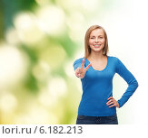 Купить «smiling teenage girl showing v-sign with hand», фото № 6182213, снято 5 декабря 2013 г. (c) Syda Productions / Фотобанк Лори
