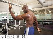 Купить «Rear view of a shirtless bodybuilder», фото № 6184861, снято 28 февраля 2014 г. (c) Wavebreak Media / Фотобанк Лори