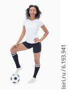 Купить «Pretty girl posing with her football», фото № 6193941, снято 30 апреля 2014 г. (c) Wavebreak Media / Фотобанк Лори