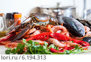 Купить «raw marine products at cooking table», фото № 6194313, снято 4 мая 2013 г. (c) Яков Филимонов / Фотобанк Лори
