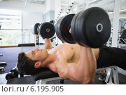 Купить «Muscular man exercising with dumbbells in gym», фото № 6195905, снято 28 февраля 2014 г. (c) Wavebreak Media / Фотобанк Лори