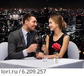 Купить «young couple with glasses of wine at restaurant», фото № 6209257, снято 9 марта 2014 г. (c) Syda Productions / Фотобанк Лори