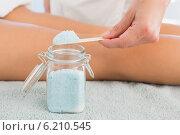 Купить «Close up of a hand using salt scrub», фото № 6210545, снято 13 марта 2014 г. (c) Wavebreak Media / Фотобанк Лори