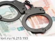 Купить «Наручники и деньги», фото № 6213193, снято 27 июня 2014 г. (c) Александр Лычагин / Фотобанк Лори