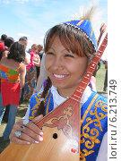 Казахская девушка на празднике наурыз (2005 год). Редакционное фото, фотограф Гуньков Валерий Анатольевич / Фотобанк Лори