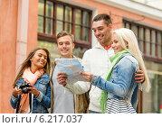 Купить «group of smiling friends with map and photocamera», фото № 6217037, снято 14 июня 2014 г. (c) Syda Productions / Фотобанк Лори