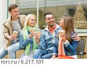 Купить «group of smiling friends with take away coffee», фото № 6217101, снято 14 июня 2014 г. (c) Syda Productions / Фотобанк Лори