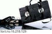 Купить «Video tape falling and bouncing on white background», видеоролик № 6218129, снято 17 января 2019 г. (c) Wavebreak Media / Фотобанк Лори