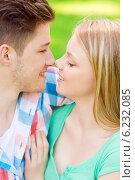 Купить «smiling couple touching noses in park», фото № 6232085, снято 7 июля 2014 г. (c) Syda Productions / Фотобанк Лори