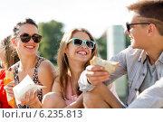 Купить «group of smiling friends sitting on city square», фото № 6235813, снято 20 июля 2014 г. (c) Syda Productions / Фотобанк Лори