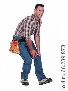 Купить «Craftsman with sore knee», фото № 6239873, снято 27 апреля 2011 г. (c) Phovoir Images / Фотобанк Лори