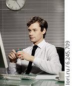 Купить «Young man in the office», фото № 6245709, снято 18 марта 2018 г. (c) BE&W Photo / Фотобанк Лори