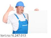Купить «Construction worker with panel», фото № 6247013, снято 7 мая 2010 г. (c) Phovoir Images / Фотобанк Лори