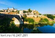 Купить «Day view of Puente de Alcantara - ancient bridge in Toledo.», фото № 6247281, снято 23 августа 2013 г. (c) Яков Филимонов / Фотобанк Лори