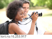 Купить «couple of tourists looking a camera», фото № 6253917, снято 16 июля 2010 г. (c) Phovoir Images / Фотобанк Лори