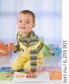Купить «Little boy playing in a child's room.», фото № 6259901, снято 26 июня 2019 г. (c) BE&W Photo / Фотобанк Лори