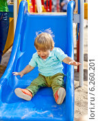 Купить «Little boy playing at the playground», фото № 6260201, снято 26 июня 2019 г. (c) BE&W Photo / Фотобанк Лори