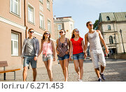 Купить «group of smiling friends walking in city», фото № 6271453, снято 20 июля 2014 г. (c) Syda Productions / Фотобанк Лори