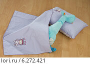 Купить «Plush toy lying under blanket on a pilllow.», фото № 6272421, снято 18 октября 2018 г. (c) BE&W Photo / Фотобанк Лори