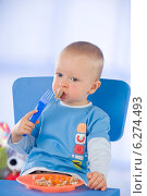 Купить «Little boy eating meal in the room», фото № 6274493, снято 21 июля 2019 г. (c) BE&W Photo / Фотобанк Лори