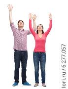 Купить «smiling teenagers with raised hands», фото № 6277057, снято 22 июня 2014 г. (c) Syda Productions / Фотобанк Лори