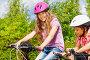 Купить «Счастливая девочка в защитном шлеме сидит на велосипеде», фото № 6278505, снято 3 июля 2014 г. (c) Сергей Новиков / Фотобанк Лори