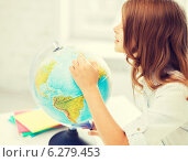 curious student girl with globe at school. Стоковое фото, фотограф Syda Productions / Фотобанк Лори
