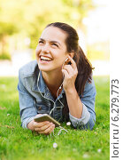 laughing young girl with smartphone and earphones. Стоковое фото, фотограф Syda Productions / Фотобанк Лори