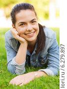 Купить «smiling young girl lying on grass», фото № 6279897, снято 11 июля 2014 г. (c) Syda Productions / Фотобанк Лори
