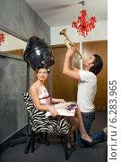 Купить «Woman drying hair and a man playing trumpet.», фото № 6283965, снято 23 марта 2019 г. (c) BE&W Photo / Фотобанк Лори