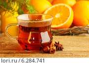 Купить «Cup of tea in beautiful christmas setting. Fir branch and tasty oranges in the background. Symbol of cozy home and relaxation in winter.», фото № 6284741, снято 22 марта 2019 г. (c) BE&W Photo / Фотобанк Лори
