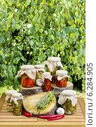 Купить «Jars of preserves on wooden table in the garden. Healthy food», фото № 6284905, снято 25 июня 2019 г. (c) BE&W Photo / Фотобанк Лори