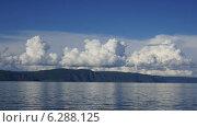 Купить «Облака над Байкалом днем. Таймлапс», видеоролик № 6288125, снято 16 августа 2014 г. (c) Павел Широков / Фотобанк Лори