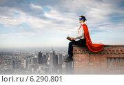 Купить «Superman with book», фото № 6290801, снято 2 июля 2020 г. (c) Sergey Nivens / Фотобанк Лори