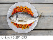 Купить «Top view of gilt-head bream fish on wooden background. Symbol of healthy living.», фото № 6291693, снято 18 августа 2018 г. (c) BE&W Photo / Фотобанк Лори