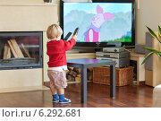 Купить «A child watching tv at home», фото № 6292681, снято 23 июля 2018 г. (c) BE&W Photo / Фотобанк Лори
