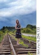 Купить «Юная деревенская девушка на железнодорожных путях перед грозой», фото № 6294133, снято 25 июня 2014 г. (c) Сергей Великанов / Фотобанк Лори