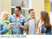 Купить «group of smiling friends with take away coffee», фото № 6296605, снято 14 июня 2014 г. (c) Syda Productions / Фотобанк Лори