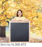 Купить «happy little girl with blank blackboard», фото № 6300473, снято 30 апреля 2014 г. (c) Syda Productions / Фотобанк Лори