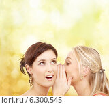 Купить «two smiling women whispering gossip», фото № 6300545, снято 29 сентября 2007 г. (c) Syda Productions / Фотобанк Лори
