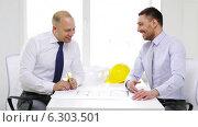Купить «Two smiling businessmen or architects in office», видеоролик № 6303501, снято 11 июня 2014 г. (c) Syda Productions / Фотобанк Лори